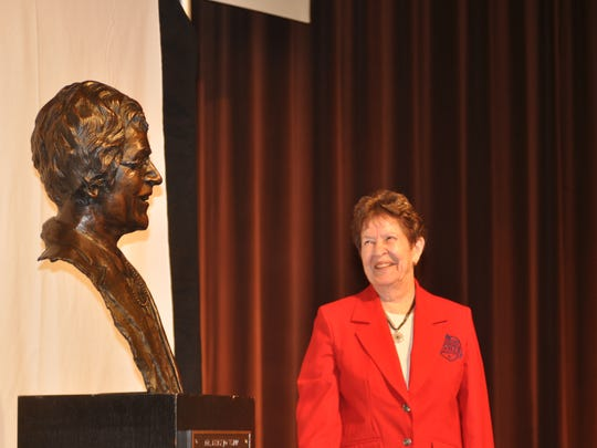 Dr. Mary Jo Wynn smiles after her bronze bust is unveiled at the Women in Sports luncheon in 2014. Wynn was honored as the first female Missouri sports legend by the Missouri Sports Hall of Fame.