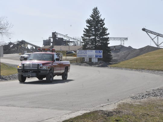 A Waite Park Fire Department truck drives away from the Martin Marietta site in Waite Park on the Sunday morning following the fires that caused nearly $3 million in damages.