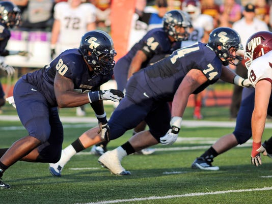 ADVANCE FOR WEEKEND EDITIONS, MAY 3-4 - In this provided by Concordia University, St. Paul,  Concordia defensive back Zach Moore (90) rushes during an NCAA Division II football game in St. Paul, Minn. Moore never got the chance to become a household name in college. NFL scouts found him anyway. playing Division II football.  (AP Photo/Concordia University, St. Paul, Justin Oakman)