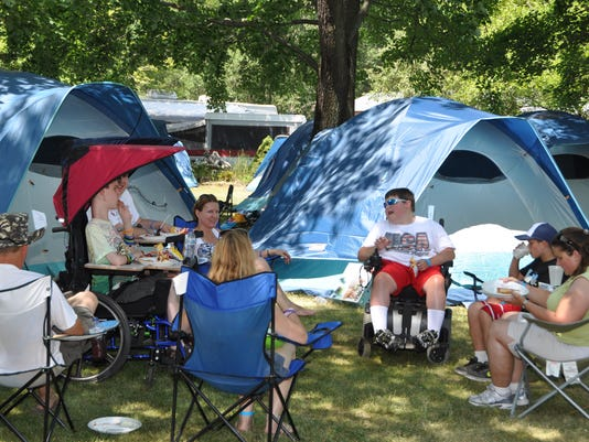 Families camping in USSA tents.JPG