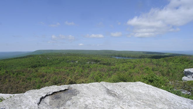Castle Point, along the Castle Point Carriage Road at Minnewaska State Park Preserve, offers views as far as New Jersey. To the right-center, one can see Awosting Lake.