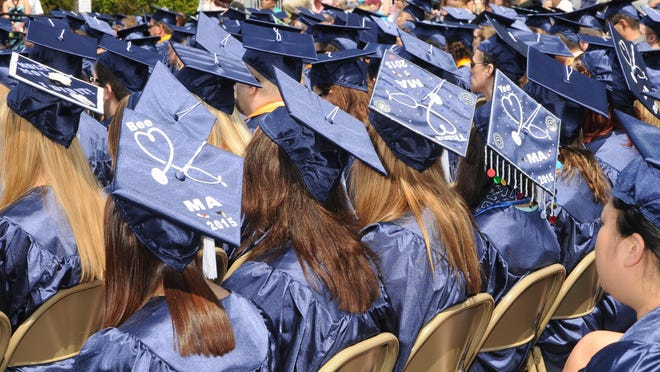 Lakeshore Technical College graduates await their walk across the stage during the May 16 commencement ceremony.