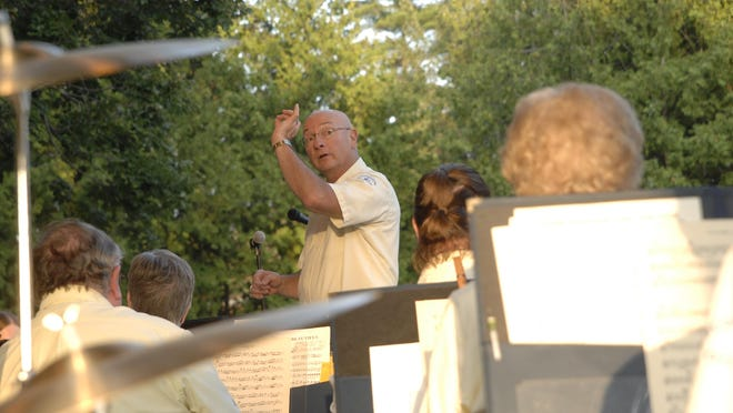 Bob Kaiser, director of the Wisconsin Rapids City Band, leads the performers at a recent concert at Robinson Park.