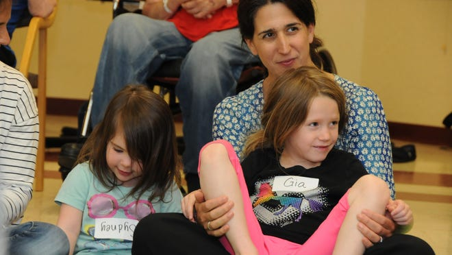 Gia Gould, right, sits in her mother Allison Gould's lap during the Generations music program at the Thompson House in Rhinebeck. Next to them is friend, Sydney Roomberg, 2 1/2, who also participated with her mother Halley and older sister Anna, who are not pictured.