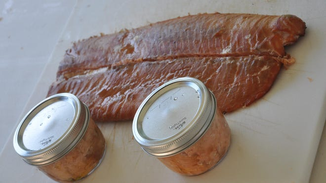 Luke and a buddy smoked and canned these salmon fillets last week. They are ready for the pressure cooker.