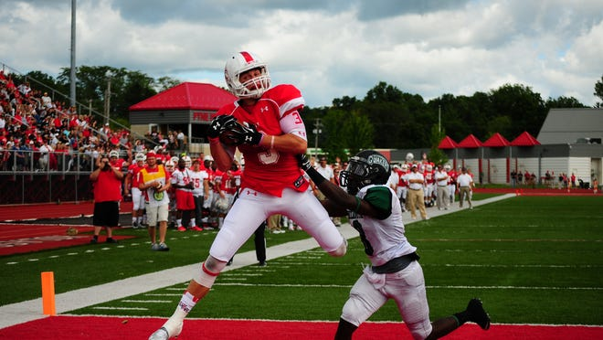 Olivet College's Kyle Bryson catches a touchdown against Wilmington on Saturday.