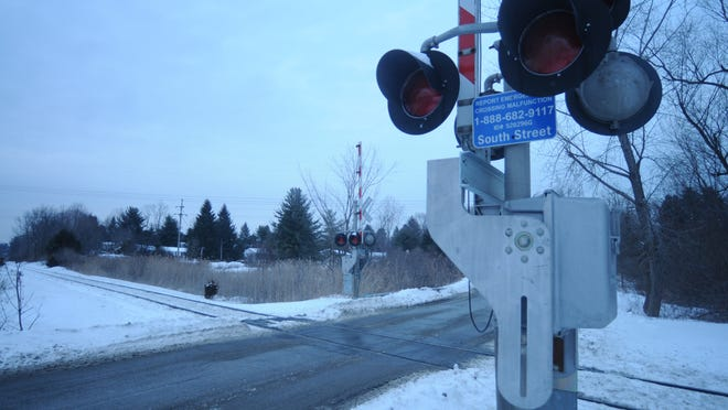 """The """"grade"""" railroad crossing at South Street in Pawling has gates that come down, lights that flash and an alarm that sounds when a train approaches."""