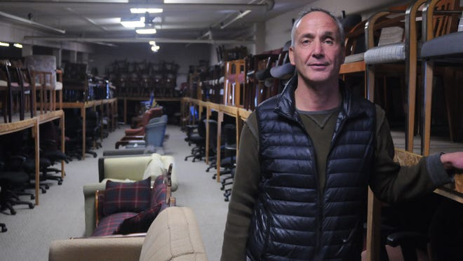 Steven Chickery, president of Hudson Valley Office Furniture, stands amidst his inventory on the fourth floor of his Poughkeepsie-based store. He is this year's recipient of Poughkeepsie Journal Business Person of the Year award.
