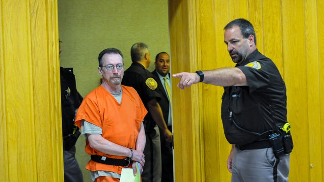Portage County Sheriff's Office Sgt. Mike Lukas directs Joseph Reinwand toward his seat in Portage County Court.