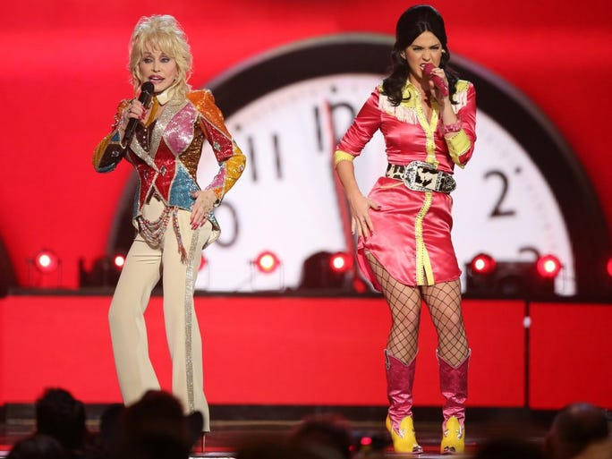 Dolly Parton, left, and Katy Perry perform 'Coat Of Many Colors' at the 51st annual Academy of Country Music Awards at the MGM Grand Garden Arena on Sunday, April 3, 2016, in Las Vegas.