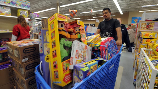 """Toy bargain hunters fill their  shopping carts a the Toys R Us in the Castleton Shopping Center early """"Black Friday"""" day, Nov. 26, 2011."""