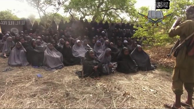 A May 12, 2014, photo taken from video by Nigeria's Boko Haram terrorist network shows the alleged missing girls abducted from the northeastern town of Chibok.
