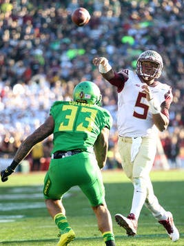 Jameis Winston throws a pass over an Oregon defender in Thursday night's Rose Bowl game. Florida State lost 59-20.