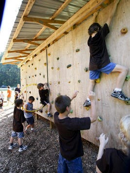 Cub Scouts work on a rock-climbing wall  at Camp Kiwanis in 2009.