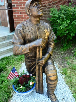 A bronze sculpture of New York Yankee great Yogi Berra by Toms River resident Brian Hanlon is part of a sculpture exhibit in downtown Toms River.