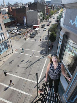 Katy Crossen on the fire escape from her fourth floor apartment on Vine Street in Over the Rhine.