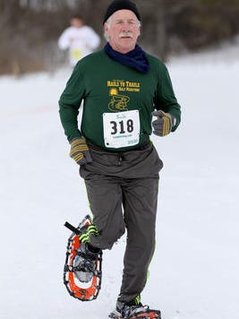 Matt Korbisch runs along the track during the snowshoe race during WinterFest at RiverEdge Golf Course in Marshfield at last year's WinterFest. This year's WinterFest takes place Saturday.
