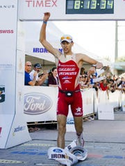 Jordan Rapp celebrates after winning the 2009 Ford Ironman Arizona triathlon.