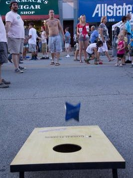 Hoosiers play cornhole on the Noblesville Courthouse Square.
