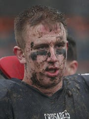 Stepinac's Ryan Hoffer is caked with mud after the