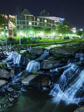 The Reedy River falls from the Liberty Bridge in downtown Greenville.