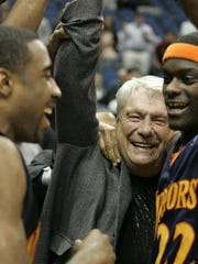 Golden State Warriors coach Don Nelson celebrates with his team after breaking the record for career coaching victories in 2010. Among the more memorable wins on Nelson's resume came in 2007, when his eighth-seeded squad upset Dallas.