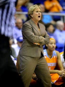 Tennessee's head coach Holly Warlick instructs her team from the sidelines during the MTSU vs Tennessee women's basketball game Friday at Murphy Center, on Nov. 8, 2013.