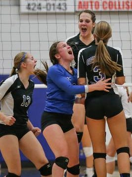 The Oshkosh West team reacts after winning the second game. The Oshkosh West Wildcats hosted the Neenah Rockets in volleyball Tuesday night, October 7, 2014.
