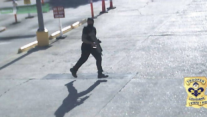 This Sunday, July 17, 2016, frame from security video provided by the Louisiana State Police shows Gavin Eugene Long carrying a weapon in Baton Rouge, La. Authorities said Long ambushed law enforcement officers fatally shooting multiple officers and injuring several others before he was killed. (Louisiana State Police via AP)