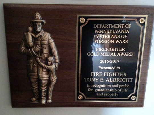 VFW award presented to Firefighter-EMT Tony Albright by the Veterans of Foreign Wars