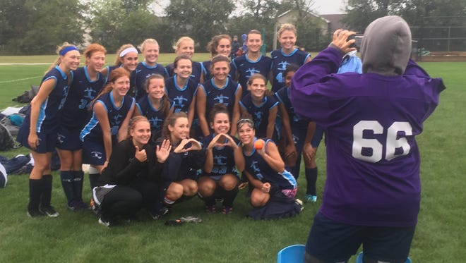 Reserve goalie Ally Krout snaps a team picture after the Dallastown field hockey team collected the program's 600th victory with a 5-1 win at New Oxford.