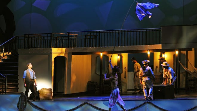 "A dancer makes a ""bird"" fly in a scene from Arizona Opera's ""Florencia en el Amazonas."""