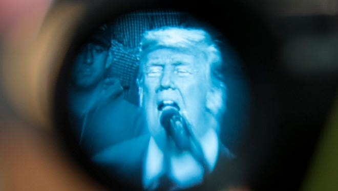 President Trump viewed through a lens in Pensacola, Fla., on Dec. 8, 2017.