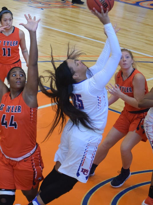 Louisiana College's Zharian Maxmillion (25) goes for two against the University of Texas at Tyler.