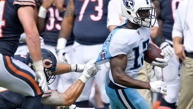 Bears linebacker Dan Skuta (57) hangs on but can't make the stop on Titans wide receiver Taywan Taylor (13) in the third quarter of a preseason game Sunday, Aug. 27, 2017, at Nissan Stadium.