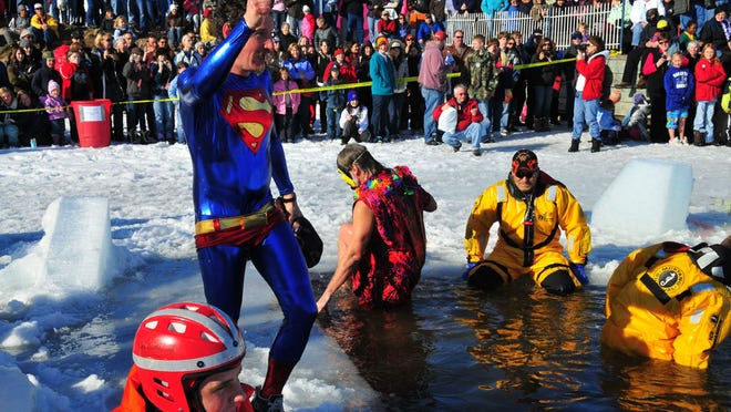 Costumed jumpers take on a polar plunge at the Bayfield Winter Festival.