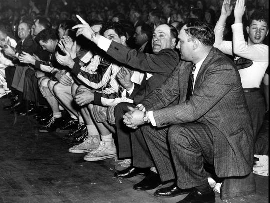 Rochester Royals owner/coach Les Harrison (center with