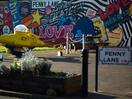 A yellow submarine and murals decorate the Penny Lane