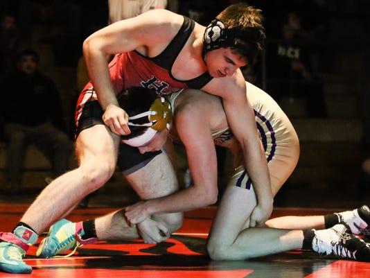 BRI EST 0211 Monroe HC wrestling