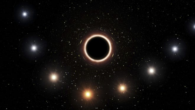 Scientists saw a black hole distort light in a way that backs Einstein's theory.