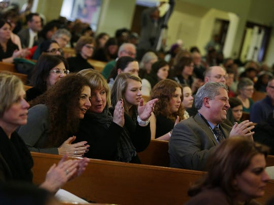 People celebrate the Fifteenth Annual World Sabbath of Religious Reconciliation at Hartford Memorial Baptist Church in Detroit in 2014.