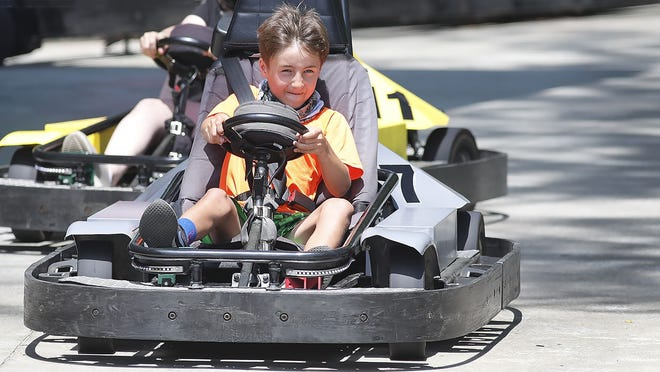 Patrick McDonough, 9, of Cohasset, rides a go-kart on his birthday Tuesday at Starland in Hanover.