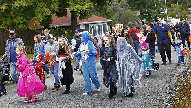 Kids and parents in the Idlewell neighborhood of North Weymouth gathered for a Halloween parade and party, kids march down Pleasantview Ave. on Sunday Oct.28, 2018 Greg Derr/ The Patriot Ledger