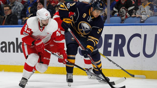 Sabres forward Evander Kane (9) is pressured by Red Wings forward Darren Helm (43) during the first period Friday in Buffalo, N.Y.