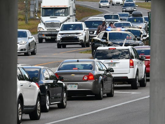 Rush-hour traffic snarled on State Road 520 near State Road 528 in April 2017 after brush fire smoke triggered road closures.
