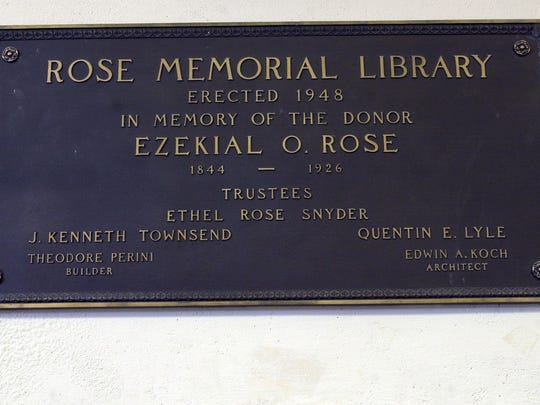 A plaque on the wall of the Rose Memorial Library on