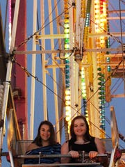 Lindsay Krell, 20, left, Ashley Marver, 20 , both of Howards Grove, wait to for the end of their Ferris Wheel ride at the Sheboygan County Fair Thursday September 3, 2015 in Plymouth.