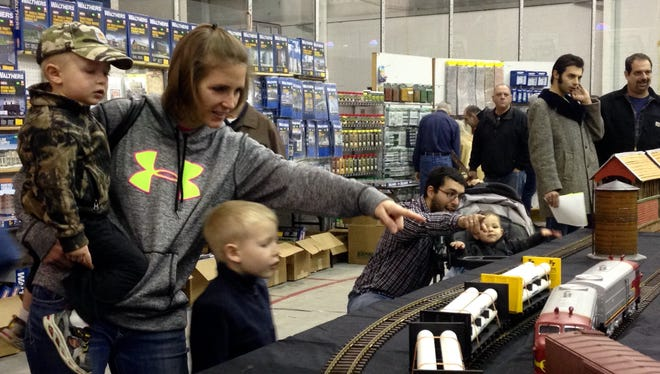 Jen Feil of Conesus, Livingston County, left, watches the model trains with sons Owen, 2, and Landon, 5, right, at Greenberg's Great Train and Toy Show in Brighton Saturday.