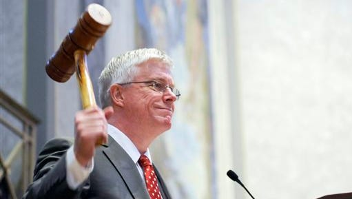 """FILE - In this Sept. 6, 2011, file photo Missouri Republican Lt. Gov. Peter Kinder gavels in the Missouri Senate in Jefferson City, Mo. Missouri's lieutenant governor is accusing Justice Department officials of """"fanning the flames of racial division,"""" as the federal agency is criticizing Ferguson police for alleged racial biases following the fatal shooting of Michael Brown, on Tuesday, March 17, 2015."""