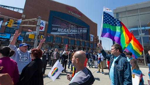 Opponents of Indiana Senate Bill 101, the Religious Freedom Restoration Act, march outside Lucas Oil Stadium, site of the NCAA Final Four, in Indianapolis on Saturday, April 4, 2015, to push for a state law that specifically bars discrimination based on sexual orientation or gender identity.